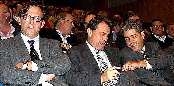 el presidente de AMI, Vila Abadal, en un acto de CiU, junto a Artur Mas y a Francesc Homs