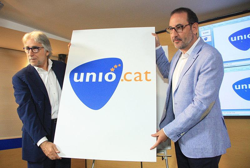Sánchez Llibre y Ramon Espadaler presentan el nuevo logotipo de UDC