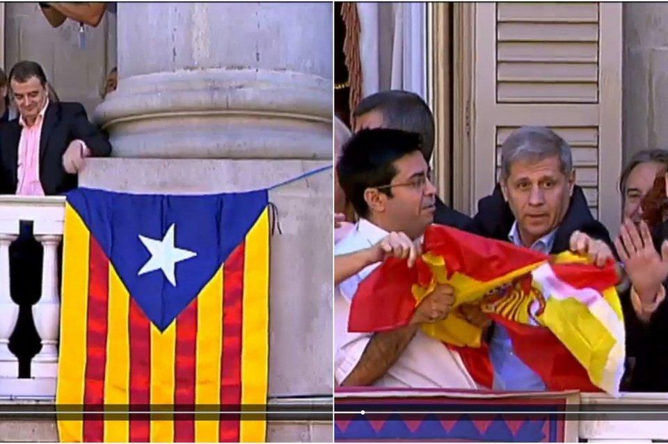 El inmigrante argentino arrancando la bandera de España y permitiendo que se mantenga el trapo separatista en el balcon del ayuntamiento.