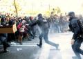 Carga de los Mozos contra encapuchados independentistas el 10-N de Jusapol